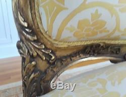 A PAIR OF French Louis XV Style (19th C) Gilt Armchairs. Upholstered in FORTUNY