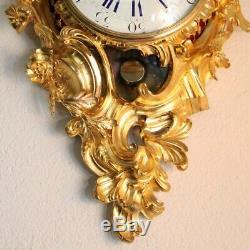 Antique French cartel wall clock of gilt bronze in the Louis XV style