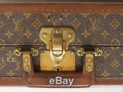 Louis Vuitton monogram suitcase trunk open by center, square handle