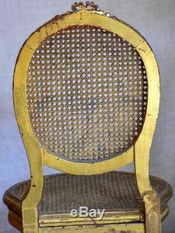 Pair of 18th Century Louis XVI gilded cane chairs