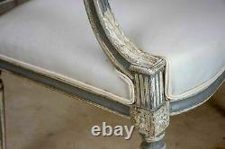 Pair of antique French Louis XVI armchairs