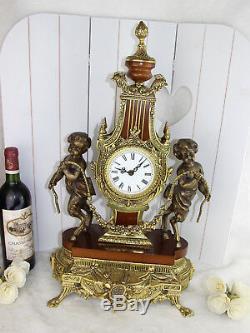 XL heavy French Putti Faun Brass wood Clock Louis XVI 1960's